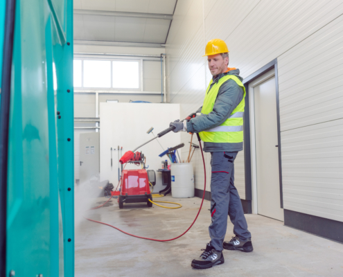 Worker cleaning a rental or mobile toilet