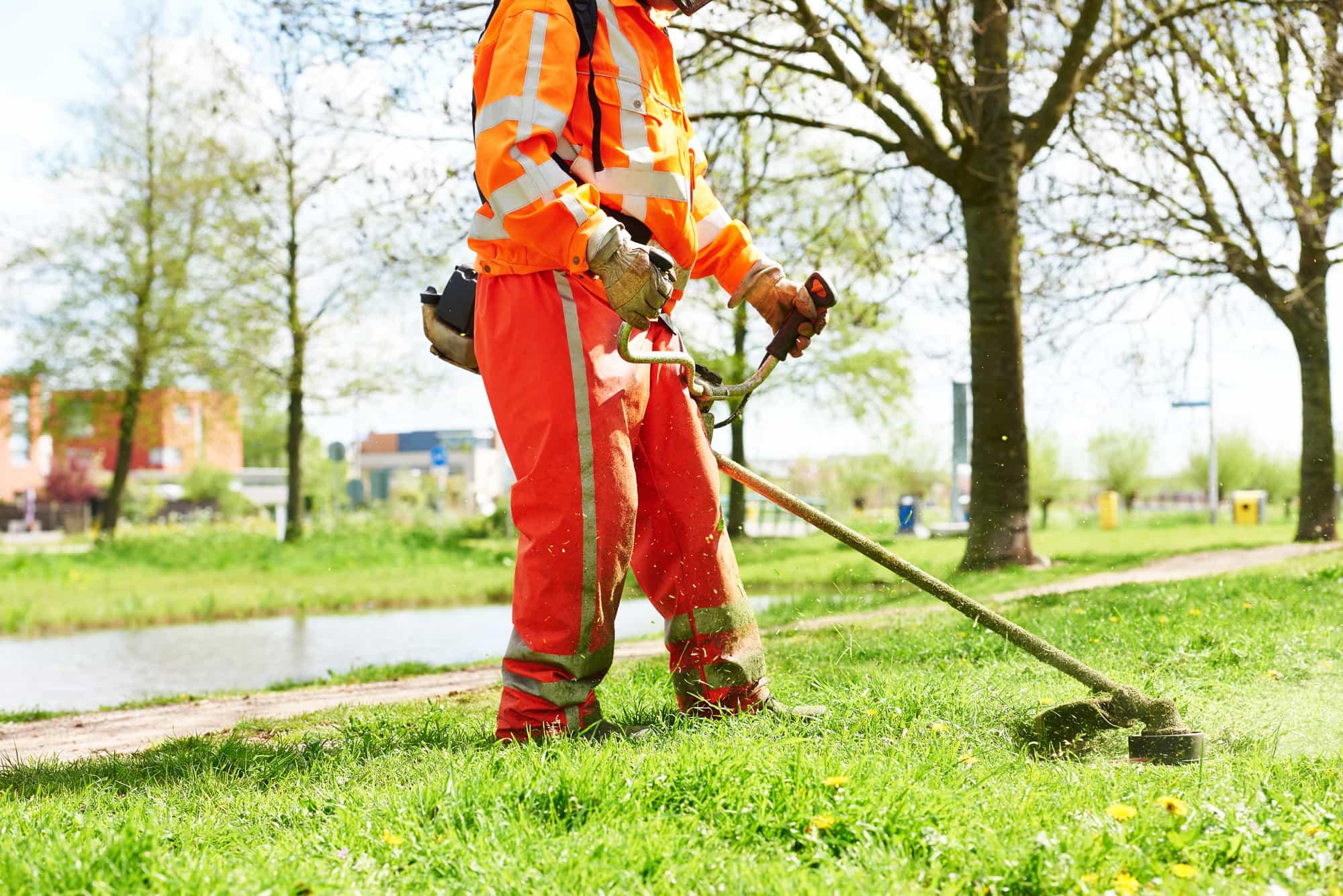 lawn mower worker man cutting grass